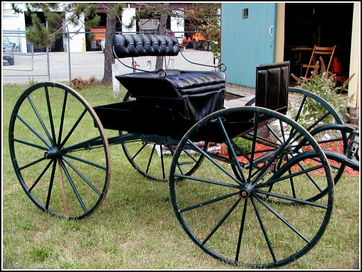 Carriage on display in front of GCHS Carriage House